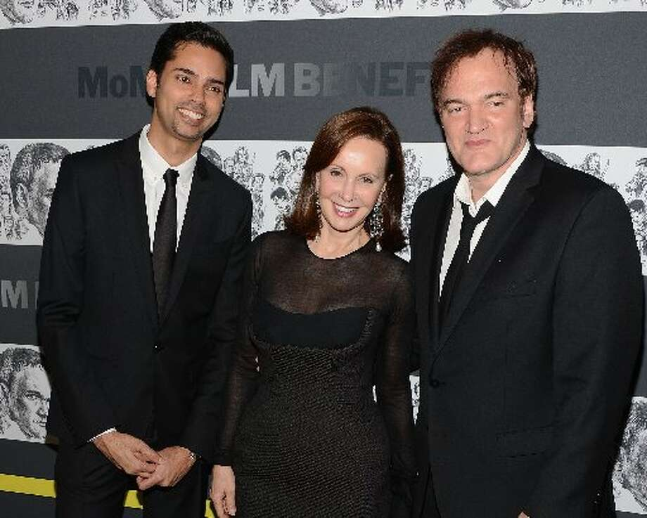 (L-R) Rajendra Roy, Marie-Josee Kravis and Quentin Tarantino attend The Museum of Modern Art Film Benefit Honoring Quentin Tarantino at MOMA on December 3, 2012 in New York City. (Photo by Andrew H. Walker/Getty Images) (Getty)