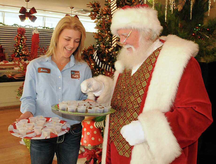 Santa chooses a fudge sample from Big Little Fudge owner Robin Strickland at the Market Street pop-up, Santa's Sweet Shop. Strickland says the seasonal shop has been good for business. Photo: David Hopper, Freelance / freelance