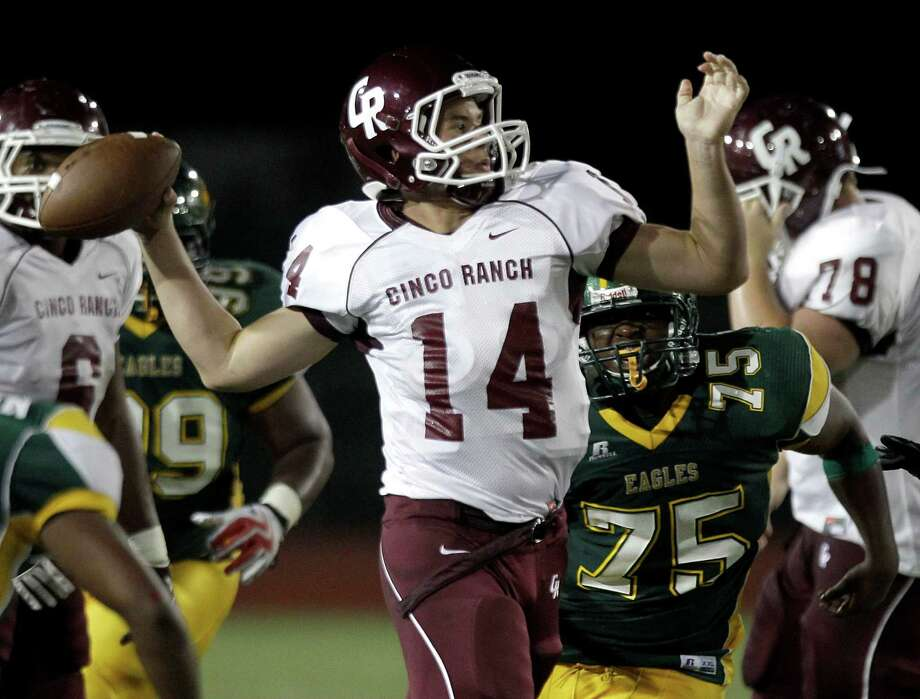 Junior quarterback Luke Klingler (14) is expected to return to lead the Cinco Ranch offense after missing all of this season with an ACL injury. Photo: Brett Coomer, HC Staff / © 2011 Houston Chronicle
