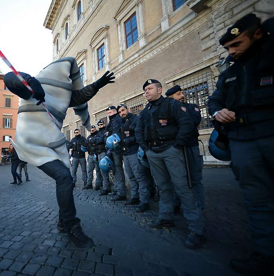 Screw head opposition:Protesters dressed as drills protest the TAV (Treno Alto Velocita - Italian for high-speed train) in front of the French Embassy in Rome. France and Italy, meanwhile, signed a deal for the contested transalpine tunnel train link. Photo: Filippo Monteforte, AFP/Getty Images