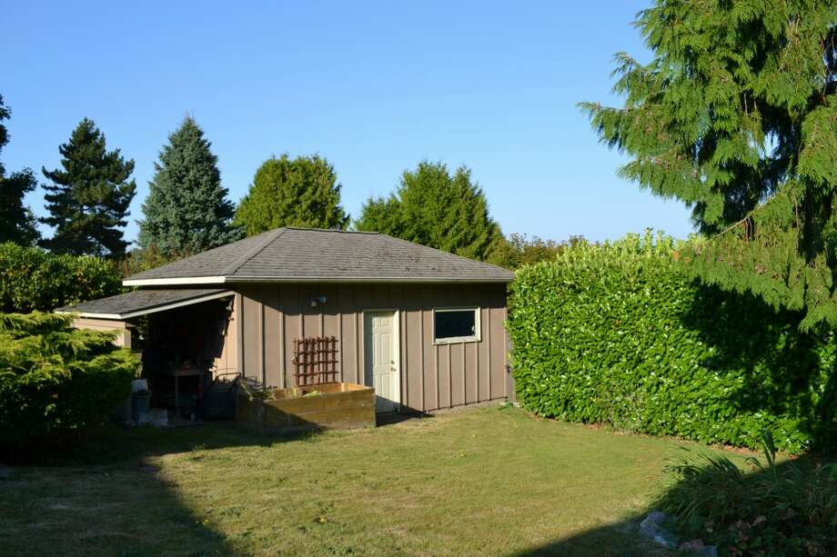Yard and detached garage of 10324 13th Ave. N.W. The 1,170-square-foot rambler, built in 1949, has three bedrooms, one bathroom, two garages and a patio on a 6,804-square-foot lot. It's listed for $389,000. Photo: Courtesy Leanne Finlay/Windermere Real Estate