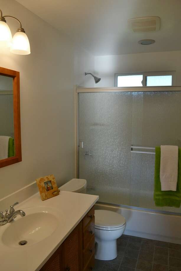 Bathroom of 10324 13th Ave. N.W. The 1,170-square-foot rambler, built in 1949, has three bedrooms, one bathroom, two garages and a patio on a 6,804-square-foot lot. It's listed for $389,000. Photo: Courtesy Leanne Finlay/Windermere Real Estate