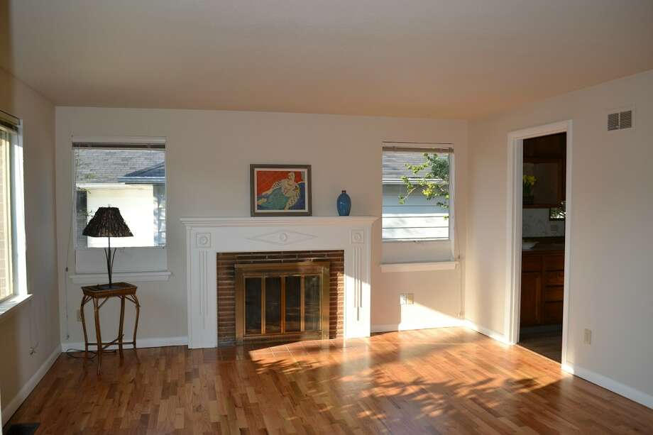 Living room of 10324 13th Ave. N.W. The 1,170-square-foot rambler, built in 1949, has three bedrooms, one bathroom, two garages and a patio on a 6,804-square-foot lot. It's listed for $389,000. Photo: Courtesy Leanne Finlay/Windermere Real Estate
