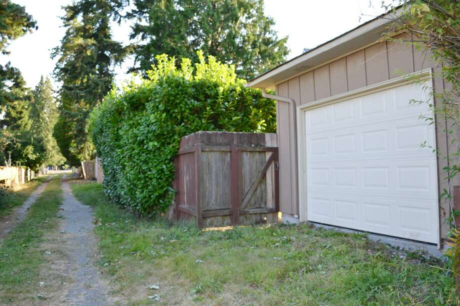 Alley and detached garage of 10324 13th Ave. N.W. The 1,170-square-foot rambler, built in 1949, has three bedrooms, one bathroom, two garages and a patio on a 6,804-square-foot lot. It's listed for $389,000. Photo: Courtesy Leanne Finlay/Windermere Real Estate