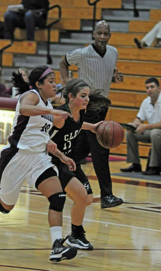 "Clear Falls senior point guard Madison Ruta moved the ball up the floor in a 52-39 victory at Cinco Ranch during the Katy ISD Tournament last week. She is the Lady Knights' floor captain ""without a doubt"" said Clear Falls coach Shannon Osborne. Photo: L. Scott Hainline, Freelance / Freelance"