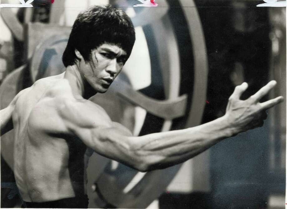 Bruce Lee —The martial arts master became a legend in America with TV roles like Kato on The Green Hornet and movies like the kung fu classic Enter the Dragon. (Archive)