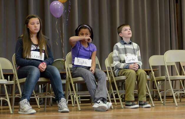 The finalists, from left to right, Kionna Murray of School 2,  Kyla McFadden of Carroll Hill and Carter Washock of School 16 at the Seventh Annual Spelling Bee put on at W.K. Doyle Middle School by the Enlarged City School District of Troy, N.Y. Dec. 4, 2012. (Skip Dickstein/Times Union) Photo: Skip Dickstein / 00020335A