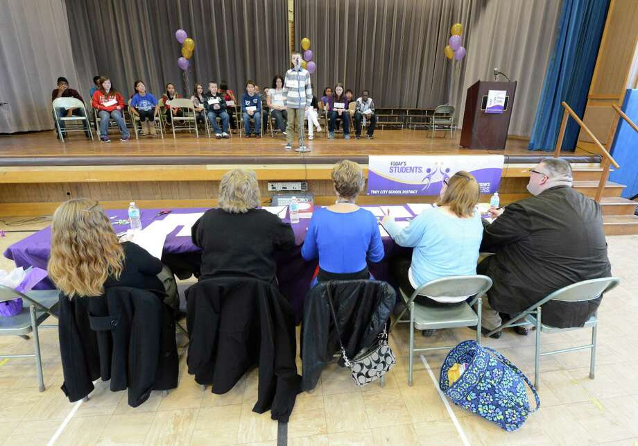 Contestant Carter Washock of Troy School 16 stands in front of the judges during the Seventh Annual Spelling Bee put on at W.K. Doyle Middle School by the Enlarged City School district of  Troy, N.Y. Dec. 4, 2012. (Skip Dickstein/Times Union) Photo: Skip Dickstein / 00020335A