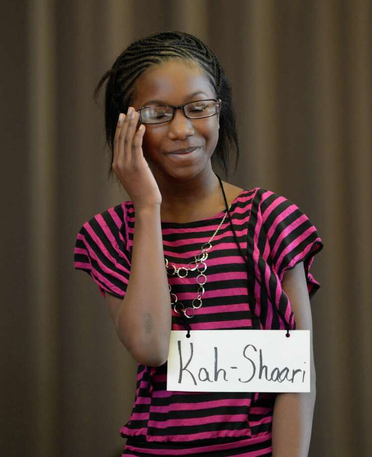 Contestant Kah-Shaari Grier, representing the Doyle Middle School, works hard to come up with the correct spelling of a word as she stands in front of the judges during the Seventh Annual Spelling Bee put on at W.K. Doyle Middle School by the Enlarged City School district of   Troy, N.Y. Dec. 4, 2012. (Skip Dickstein/Times Union) Photo: Skip Dickstein / 00020335A