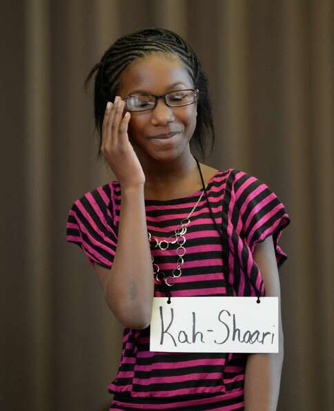 Contestant Kah-Shaari Grier, representing the Doyle Middle School, works hard to come up with the co