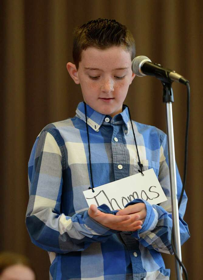 Contestant Thomas Harkin, representing the School 18, works hard to come up with the correct spelling of a word as he stands in front of the judges during the Seventh Annual Spelling Bee put on at W.K. Doyle Middle School by the Enlarged City School district of   Troy, N.Y. Dec. 4, 2012. (Skip Dickstein/Times Union) Photo: Skip Dickstein / 00020335A