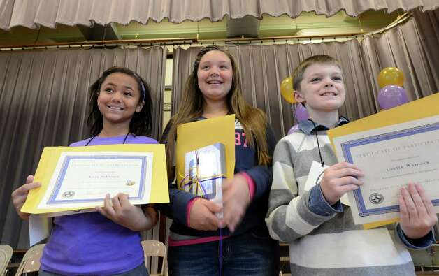 The finalists from left to right; Kyla McFadden of Carroll Hill School; First Finalist Kionna Murray of School 2; and Carter Warshock of School 16 on stage with their awards after the Seventh Annual Spelling Bee put on at W.K. Doyle Middle School by the Enlarged City School district of   Troy, N.Y. Dec. 4, 2012. (Skip Dickstein/Times Union) Photo: Skip Dickstein / 00020335A