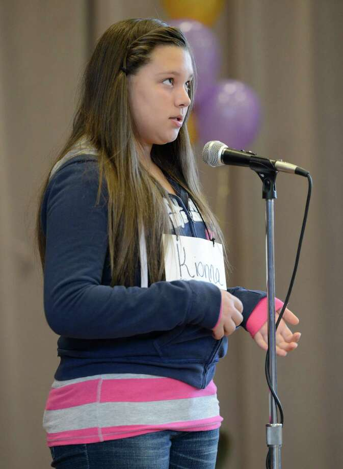 Eventual First Finalist Kionna Murray, representing School 2, works hard to come up with the correct spelling of a word as she stands in front of the judges during the Seventh Annual Spelling Bee put on at W.K. Doyle Middle School by the Enlarged City School District of   Troy, N.Y. Dec. 4, 2012. (Skip Dickstein/Times Union) Photo: Skip Dickstein / 00020335A