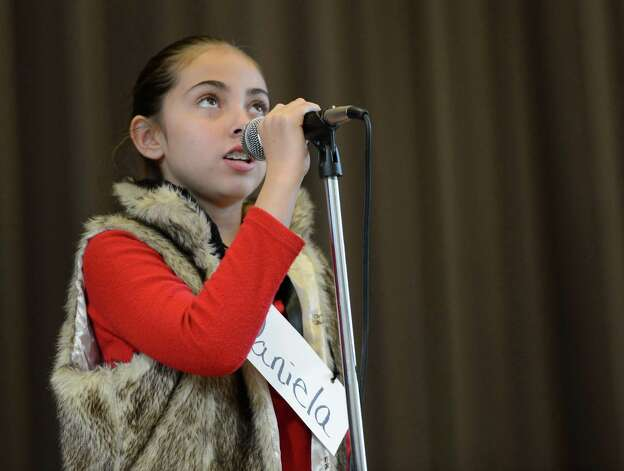 Daniela Withington, representing the Carroll Hill School,  works hard to come up with the correct spelling of a word as she stands in front of the judges during the Seventh Annual Spelling Bee put on at W.K. Doyle Middle School by the Enlarged City School District of   Troy, N.Y. Dec. 4, 2012. (Skip Dickstein/Times Union) Photo: Skip Dickstein / 00020335A