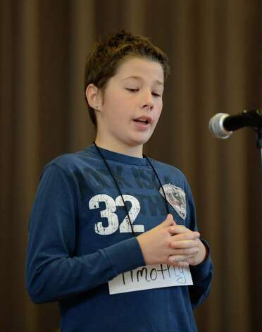 Timothy Bull-Snyder, representing the Doyle Middle School, works hard to come up with the correct spelling of a word as he stands in front of the judges during the Seventh Annual Spelling Bee put on at W.K. Doyle Middle School by the Enlarged City School District of   Troy, N.Y. Dec. 4, 2012. (Skip Dickstein/Times Union) Photo: Skip Dickstein / 00020335A