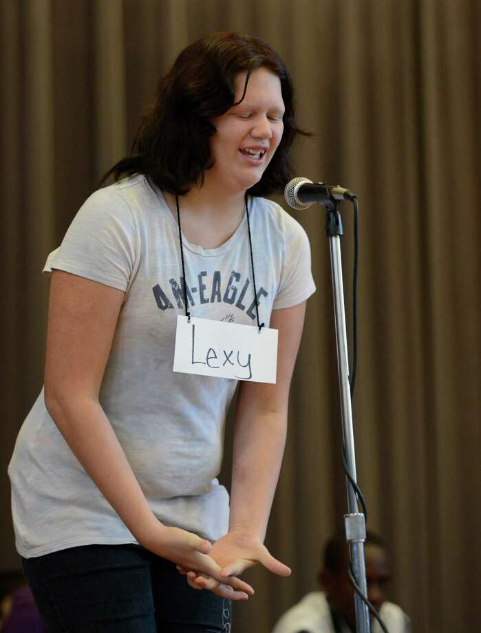 "Lexy Despart, representing the Doyle Middle School, grimaces as she tries to spell ""worthwhile"" during the Seventh Annual Spelling Bee put on at W.K. Doyle Middle School by the Enlarged City School District of  Troy, N.Y. Dec. 4, 2012. (Skip Dickstein/Times Union) Photo: Skip Dickstein / 00020335A"