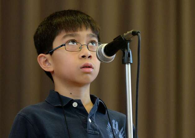 Kemal Pelugnan, representing School 14,  looks skyward for help with the correct spelling of a word as he stands in front of the judges during the Seventh Annual Spelling Bee put on at W.K. Doyle Middle School by the Enlarged City School District of   Troy, N.Y. Dec. 4, 2012. (Skip Dickstein/Times Union) Photo: Skip Dickstein / 00020335A