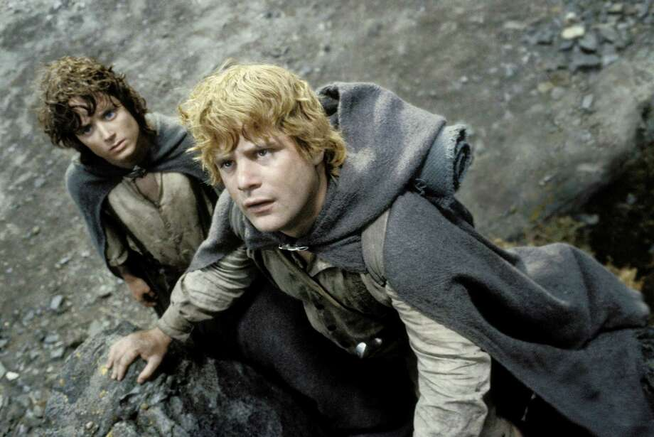 "Frodo (Elijah Wood, left) and Sam (Sean Astin) begin their climb up Mount Doom in a scene from ""The Lord of the Rings: The Return of the King"" Photo: NEW LINE CINEMA"