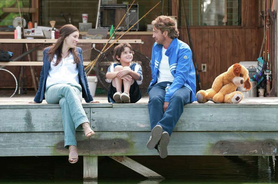 "Jessica Biel, from left, Noah Lomax and Gerard Butler star in ""Playing for Keeps,"" directed by Gabriele Muccino. (Dale Robinette/Courtesy FilmDistrict/MCT) Photo: HANDOUT, McClatchy-Tribune News Service / MCT"