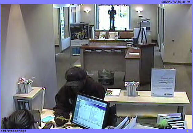 A security camera image shows a man who police said passed a note to a teller demanding money at the First Niagara Bank on Amity Road in Woodbridge on Thursday, March 8, 2012. Photo: Contributed