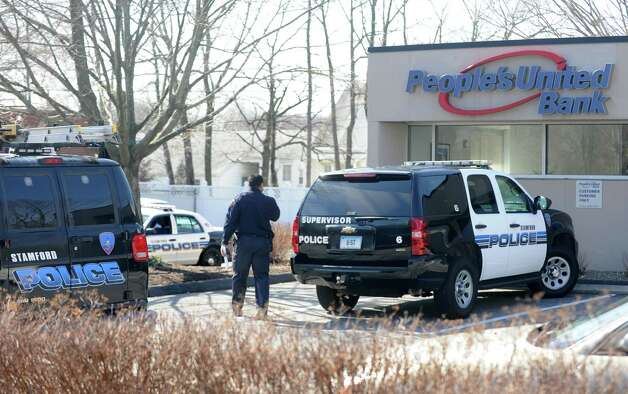 Police are investigating a bank robbery at People's United Bank on Summer St. in Stamford, Conn. on Monday, March 12, 2012. Police Capt. Tom Wuennemann said the bank was held up at 10:32 a.m. by one man who passed a note to a teller. No weapon was seen during the robbery. Photo: Cathy Zuraw / Connecticut Post