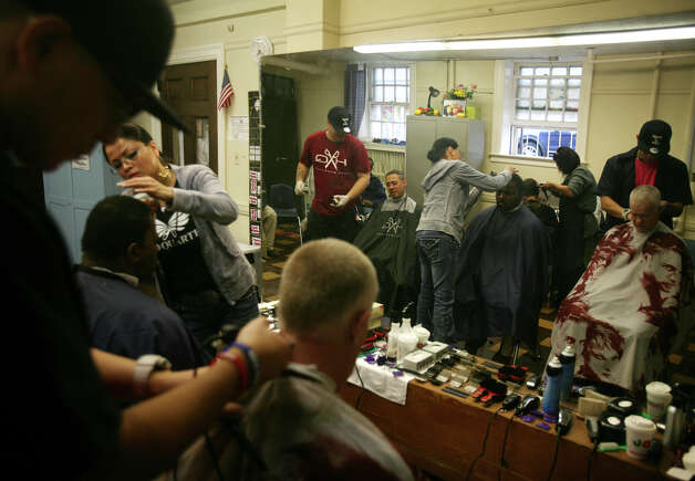 The homeless receive free haircuts at the eighth annual Project Homeless Connect event at the United Congregational Church in Bridgeport on Tuesday, December 4, 2012. Photo: Brian A. Pounds / Connecticut Post