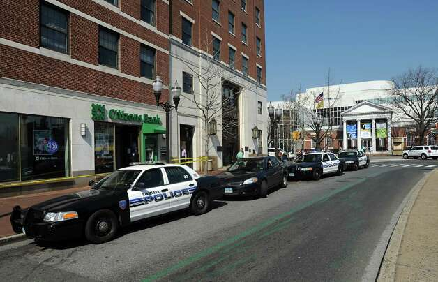 Citizens Bank at Broad and Atlantic streets in Stamford, Conn. was reportedly robbed at noon on Monday, March 19, 2012. The robber tossed a bag of money out of his car window after a red dye pack exploded. A stack of red money landed in parking spaces along Atlantic near the Palace Theatre, Stamford police Capt. Richard Conklin said. Photo: Cathy Zuraw / Stamford Advocate