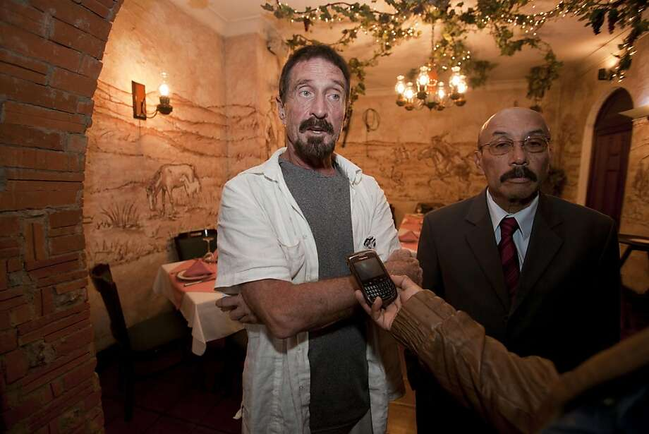 John McAfee (left), under suspicion in connection with the slaying of a neighbor in Belize, surfaces with his lawyer, Telésforo Guerra, in Guatemala, where McAfee has requested asylum. Photo: Moises Castillo, Associated Press
