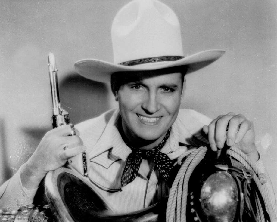 Top: The H-E-B Christmas commercial features towns with Christmassy names. Above: Singing cowboy star Gene Autry. / AP
