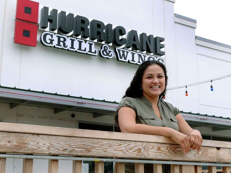 Amanda Concha, 29, is a Broker and Principal of Core Commercial. One of her clients is Hurricane Grill & Wings on Southeast Military Drive. Sept. 28, 2012. Photo: Billy Calzada, San Antonio Express-News / © San Antonio Express-News