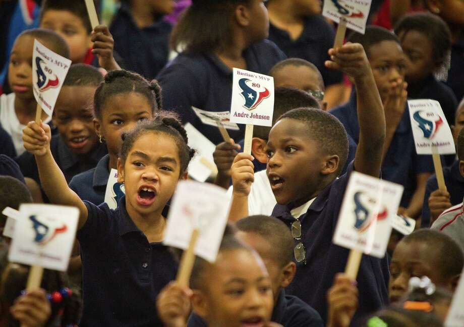 Yasmine Wright, 7, and other second grade students yell Andre Johnson's name during a Christmas program organized by Houston Police Department's Blue Santa and the Houston Texans' receiver, Tuesday, Dec. 4, 2012, in Mamie Sue Bastian Elementary in Houston. Photo: Nick De La Torre, Houston Chronicle / © 2012  Houston Chronicle