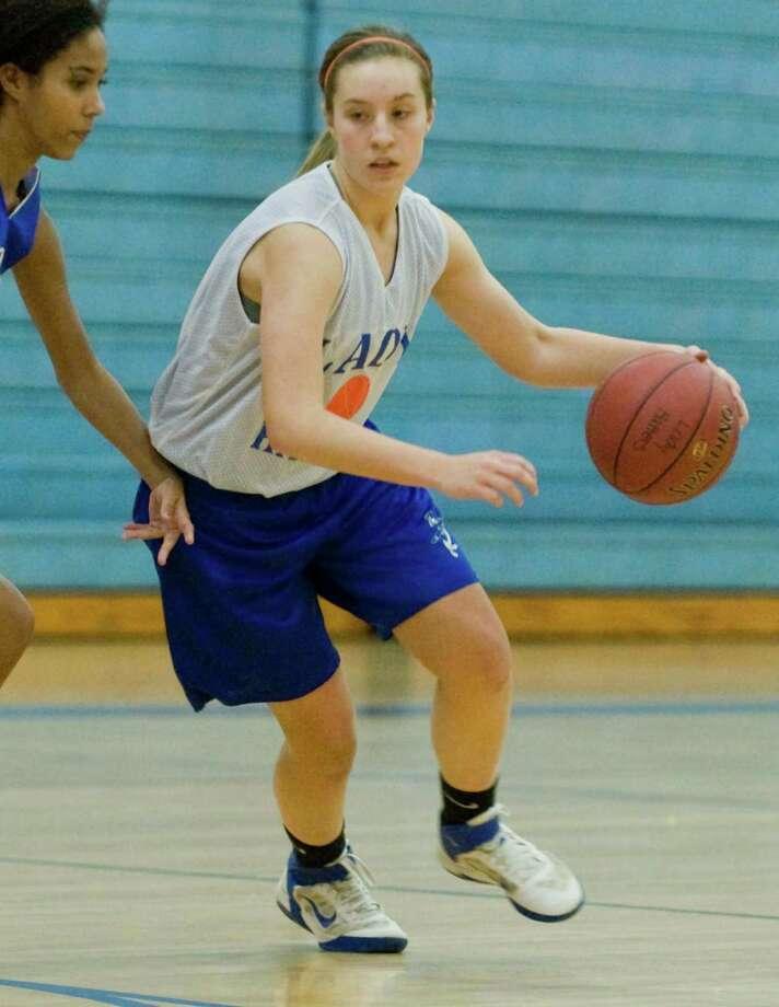 Rachel Gartner moves to the net during a Danbury High School girls basketball practice. Monday, Dec. 3, 2012 Photo: Scott Mullin / The News-Times Freelance
