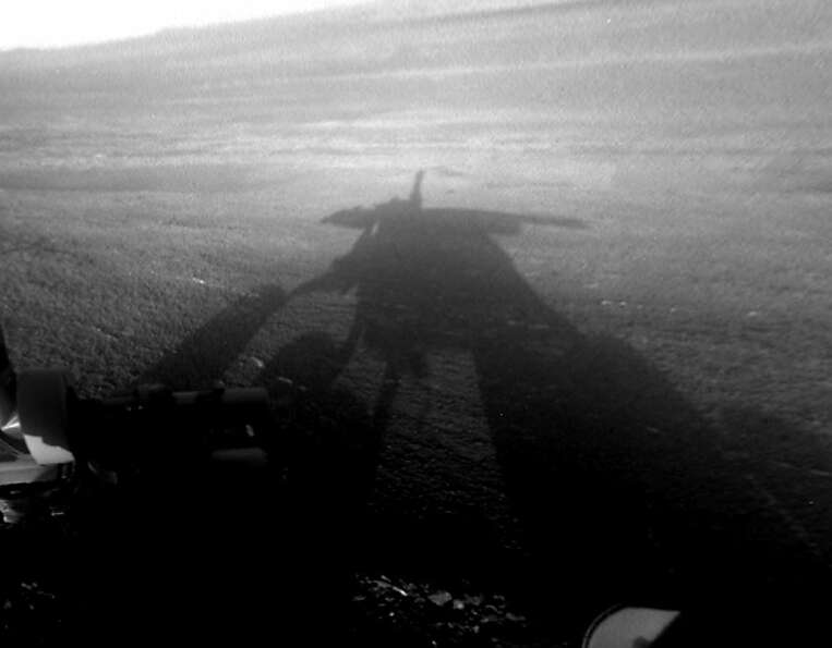 This image shows a shadow self-portrait taken by NASA's 9-year-old rover Opportunity on the surface