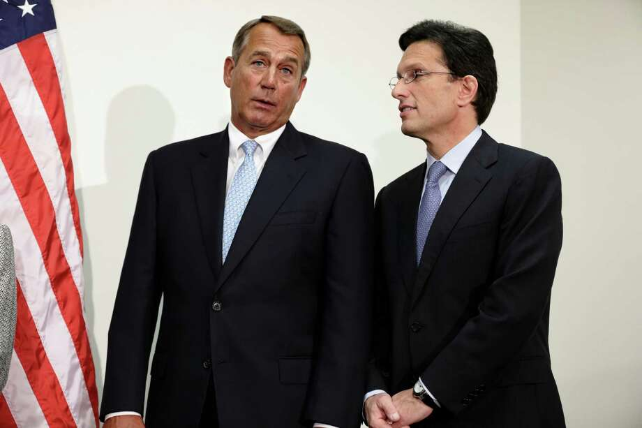 House Speaker John Boehner talks with House Majority Leader Eric Cantor. Republicans should accept a tax hike and force a Grand Bargain that actually makes significant cuts. Photo: J. Scott Applewhite, Associated Press / AP
