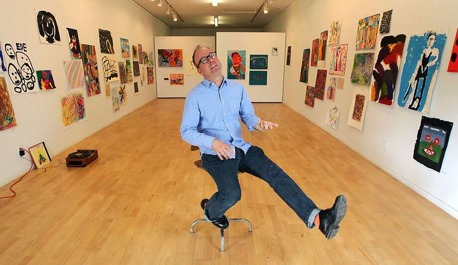 Tim Buckwalter, new gallery director of NIAD Art Center, which represents disabled artists, plays air guitar in the gallery. Photo: Lance Iversen, The Chronicle