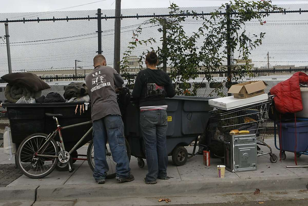 Homeless men with their belongings packed outside of their homeless encampment under highway 280 on King at Fifth streets in San Francisco, Calif., on Monday, September 24, 2012. They received a notice this weekend to clear the premises by Monday.