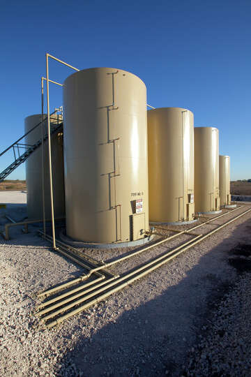 Tanks at a production location at Marathon Oil Corp.'s operations in the Eagle Ford Shale formation