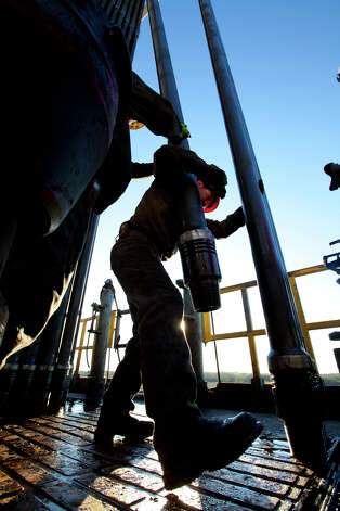 Work on a drilling rig at Marathon Oil Corp.'s operations in the Eagle Ford Shale formation in South Texas. (Photo courtesy of Marathon Oil) Photo: Marathon Oil Corp. / ©2011 Ken Childress Photography