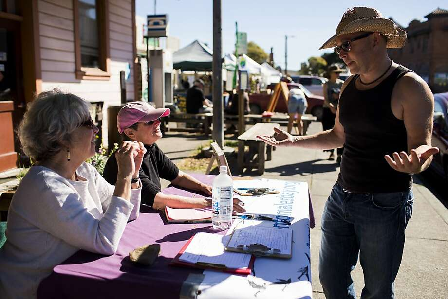(L-R) Action Tomales Bay members Susan Burns and Susan Sasso speak with Andy Hill, of Inverness, as he expresses uncertainty regarding the group's petition to the California Department of Fish and Game to stop waterfowl gaming in Tomales Bay Ecological Reserve outside a post office at Point Reyes Station, Calif. on Saturday, Oct. 27, 2012. Though waterfowl gaming is currently legal in the Reserve, members of the action argue that the gaming creates unacceptable noise disturbances during early morning and evening hours and puts recreational users of the bay at risk when killing fowls over a narrow water strip as they fly toward the connecting Giacomini Wetlands. Photo: Stephen Lam, Special To The Chronicle