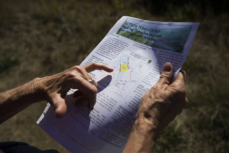 Action Tomales Bay co-founder Susan Prince shows a map of Tomales Bay Ecological Reserve in Bivalve, Calif. on Saturday, Oct. 27, 2012. The group is seeking to petition the California Department of Fish and Game to stop waterfowl gaming in Tomales Bay Ecological Reserve outside a post office Though waterfowl gaming is currently legal in the Reserve, members of the action argue that the gaming creates unacceptable noise disturbances during early morning and evening hours and puts recreational users of the bay at risk when killing fowls over a narrow water strip as they fly toward the connecting Giacomini Wetlands. Photo: Stephen Lam, Special To The Chronicle