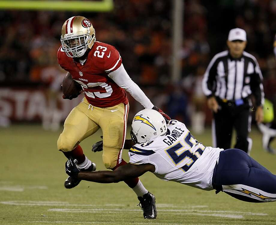 LaMichael James carries against the Chargers in an exhibition, but the rookie hasn't played during the regular season. Photo: Brant Ward, The Chronicle