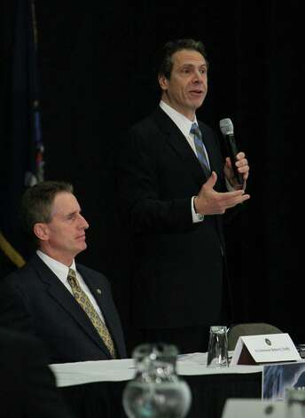 Governor Andrew Cuomo spoke after he was presented with the Buffalo Billion Investment Development Pan by the Western New York Regional economic Development Council at the Buffalo Niagara Convention Center, Tuesday, Dec. 4, 2012. On left is Lt. Governor Robert Duffy. (Sharon Cantillon / Buffalo News) Photo: Sharon Cantillon / Copyright 2012, The Buffalo News
