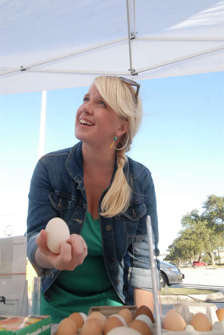Natasha Calvert (Whole Foods) checks out a duck egg (from Dennis Alexander of Renaissance Chicken in Sealy) at the Urban Harvest Farmers Market at Houston Community College Friday 11/16/12. Photo by Tony Bullard. Photo:  Tony Bullard 2012, Freelance Photographer / © Tony Bullard & the Houston Chronicle