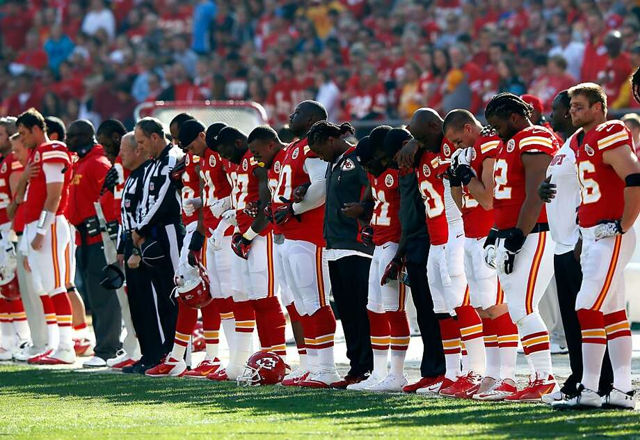 The Kansas City Chiefs pause to remember fallen teammate Jovan Belcher on Sunday, the day after he killed the mother of his child and himself. Photo: Jamie Squire, Getty Images