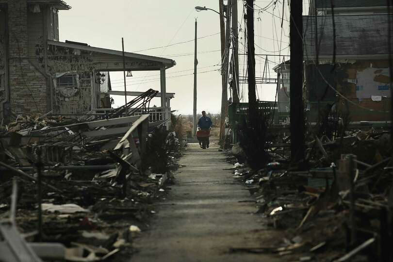 Debris is viewed outside of destroyed homes December 4, 2012 in the Breezy Point neighborhood of the