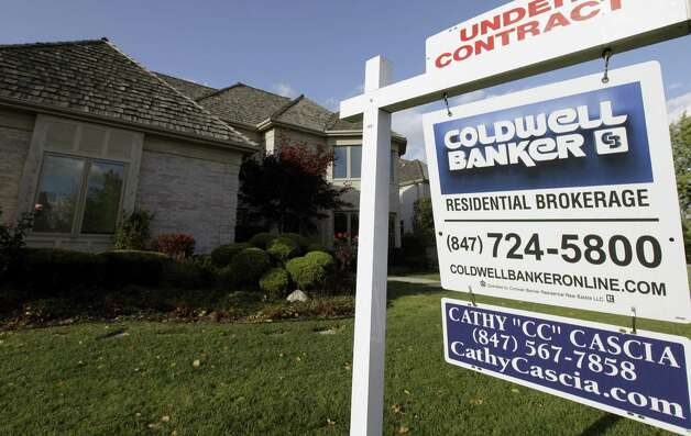 In this Wednesday, Oct. 10, 2012, photo, an under contract sign sits outside a home in Glen, Ill. A measure of U.S. home prices rose 6.3 percent in October compared with a year ago, the largest yearly gain since July 2006. Photo: Nam Y. Huh, Associated Press / Associated Press