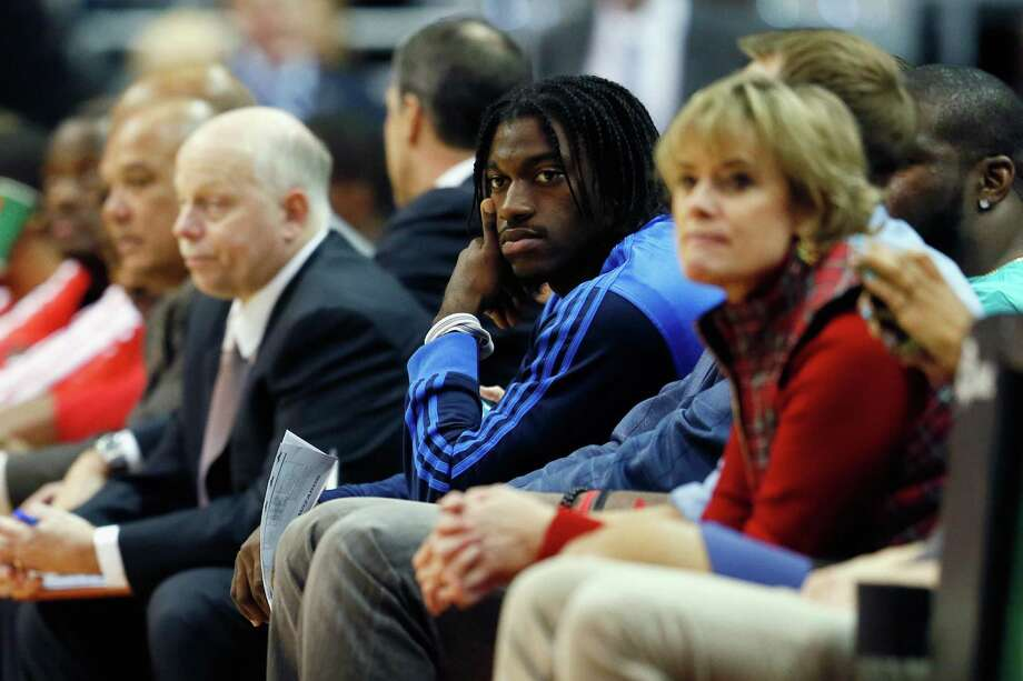 WASHINGTON, DC - DECEMBER 04: Quarterback Robert Griffin III #10 of the Washington Redskins (C) watches the first half of the Miami Heat and Washington Wizards game at Verizon Center on December 4, 2012 in Washington, DC. NOTE TO USER: User expressly acknowledges and agrees that, by downloading and or using this photograph, User is consenting to the terms and conditions of the Getty Images License Agreement. Photo: Rob Carr, Getty Images / 2012 Getty Images
