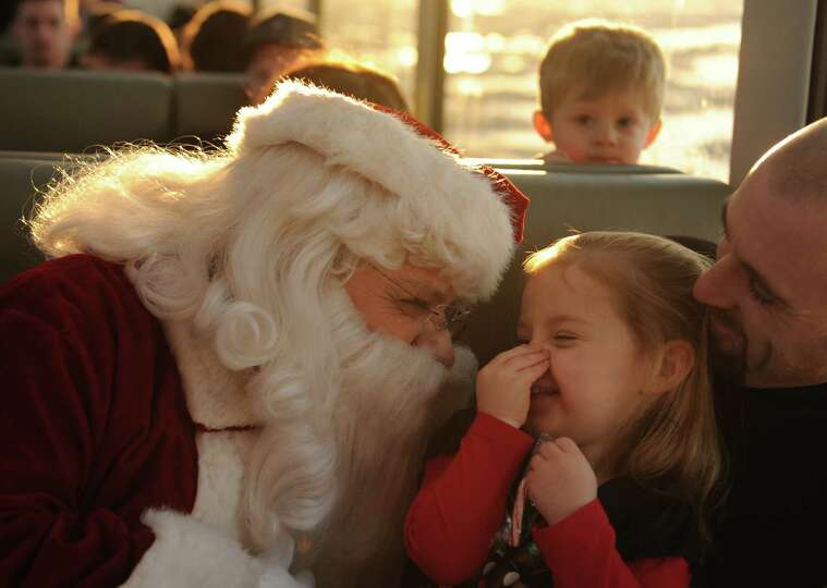 Santa Claus visits with Madilyn Bristow and her father Mike Bristow on the 2012 Alaska Railroad Holi