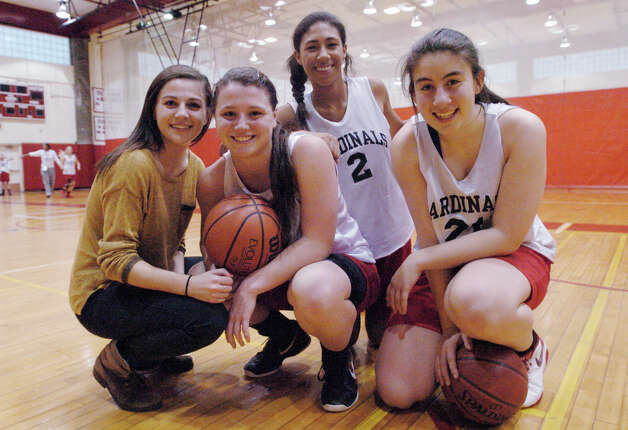 Greenwich High School girls basketball captains Danielle Ravielle, Caroline Barrett, Jenny Cespedes and Rebecca Kural at the school in Greenwich, Conn., Dec. 4, 2012. Photo: Keelin Daly / Stamford Advocate Riverbend Stamford, CT