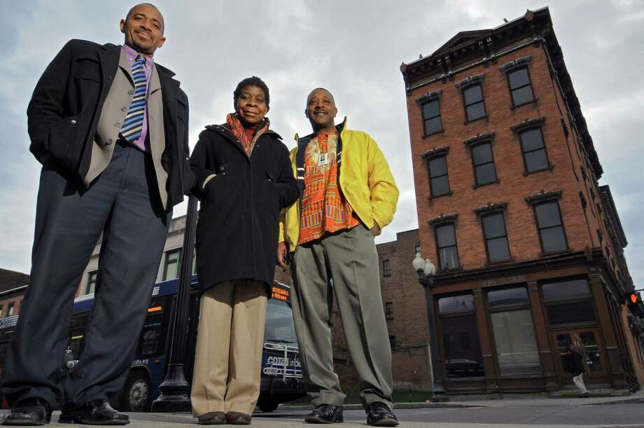 Mark Bobb-Semple, left, Alice Green, center, and Willie White stand across from the former bank building that will house the African-American Cultural Center of the Capital Region,at the corner of Madison Avenue and South Pearl Streets, seen here on Thursday March 29, 2012 in Albany, NY. (Philip Kamrass / Times Union ) Photo: Philip Kamrass / 00017031A